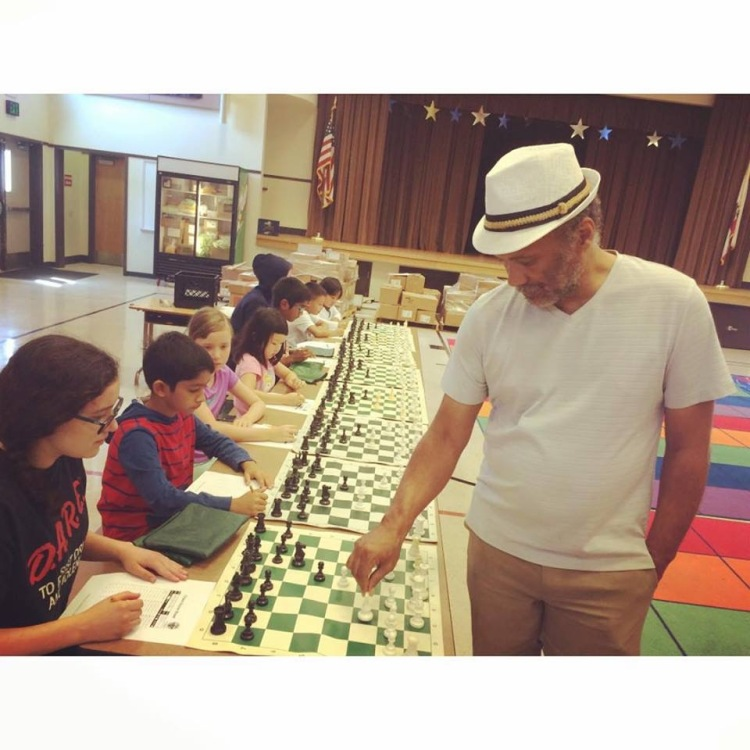 Emory Tate giving a simul at the Fremont Summer Chess Camp.