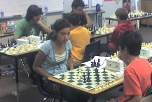Kids playing chess at a rated tournament directed by the Torres Chess and Music Academy.