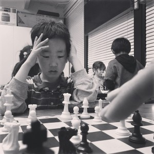Children at Achiever Institute focusing hard at chess.