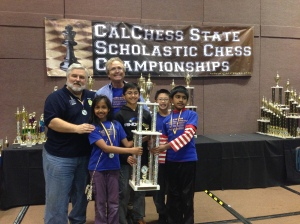 Calchess President Tom Langland with MSJE head coach Joes Lonsdale and the k-5 State Championship Team from MSJE.